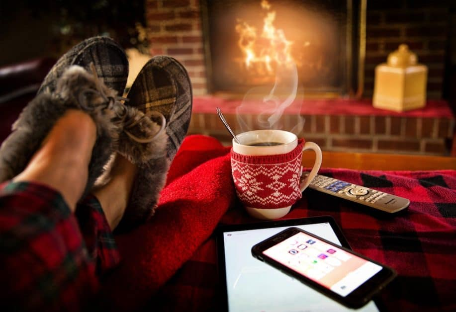 a cup of tea in front of the fire place