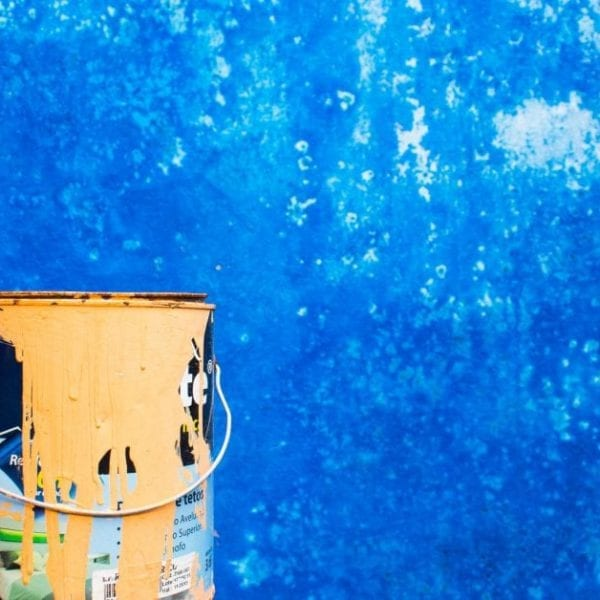 paint bucket on blue background