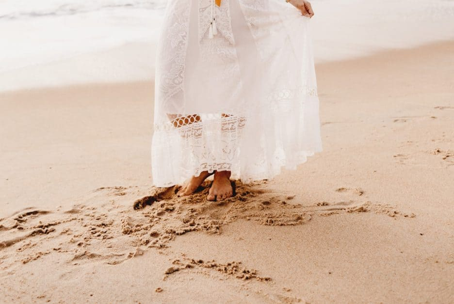 woman walking in the sand