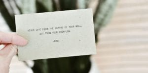 person holding card with positive statement