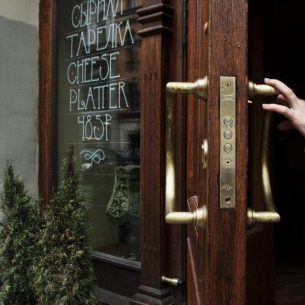 person opening a door