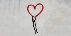 line man hanging off a heart