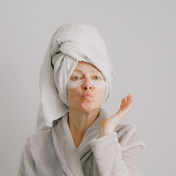 woman in dressing gown, towel turban and eye mask