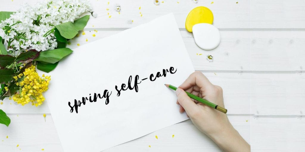 white paper and flowers spring care