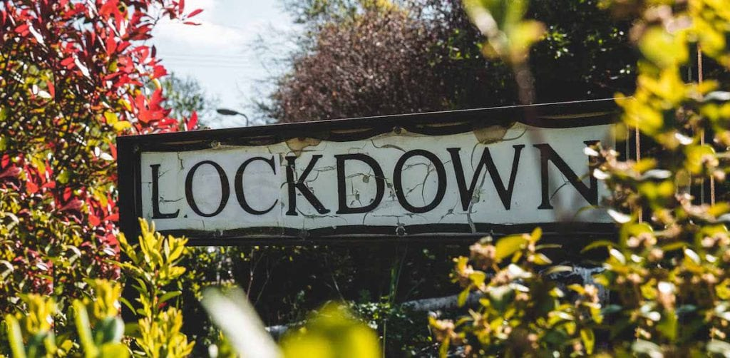 lockdown sign and trees