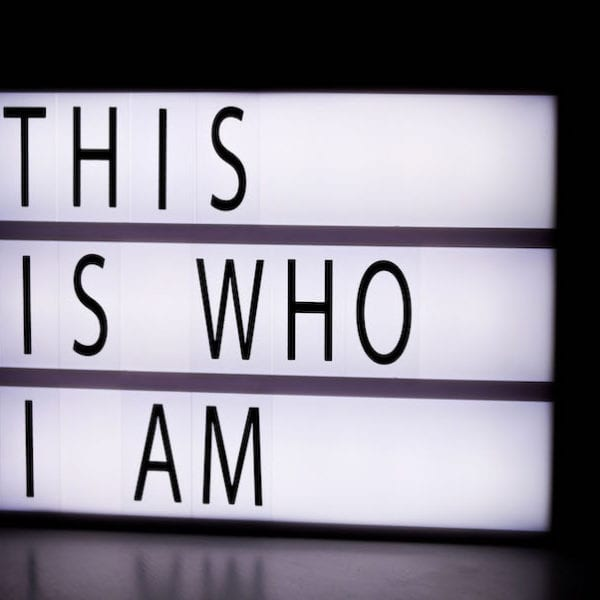 black and white sign saying this is who I am