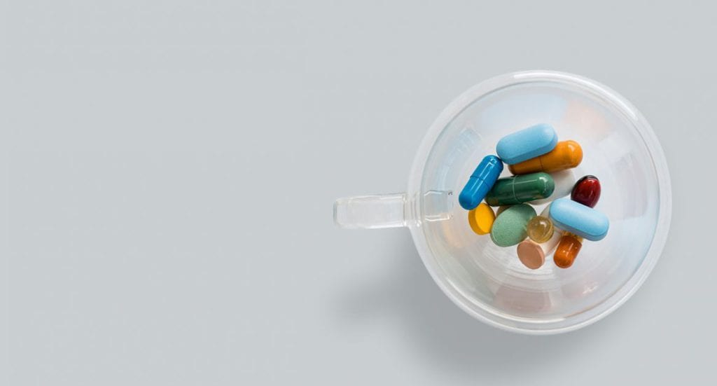 colourful pills in a cup