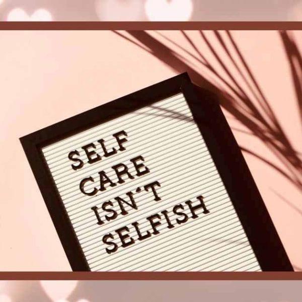 self care isn't selfish on pink and white bakcground