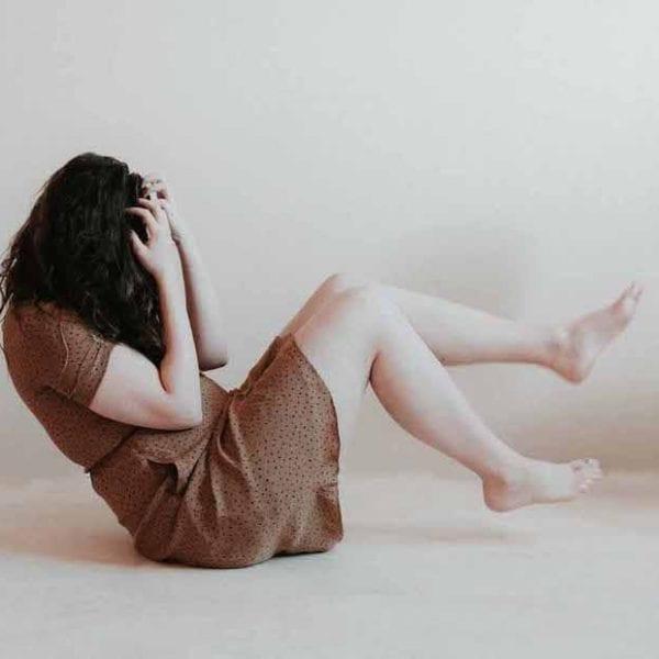 woman sat on floor