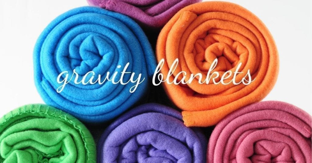 colourful blankets rolled up