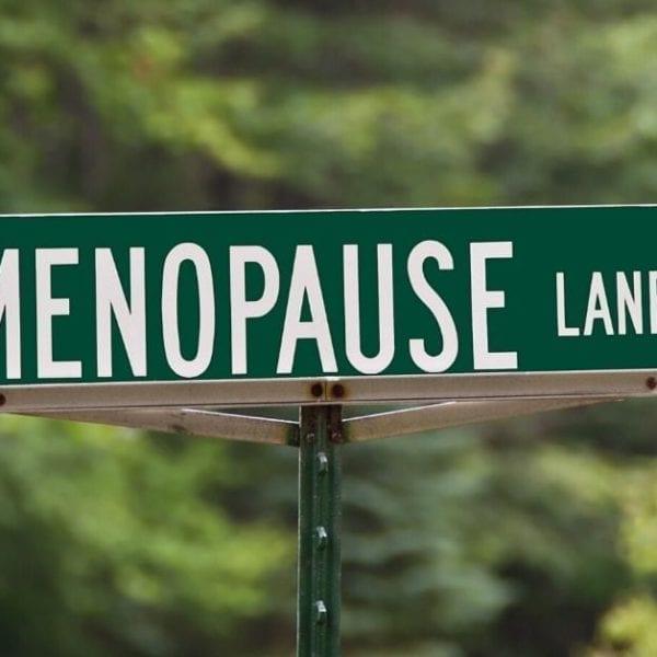 green sign saying menopause lane