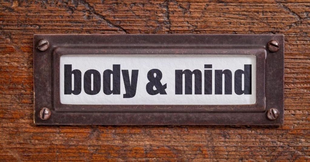 body and mind sign on wooden background