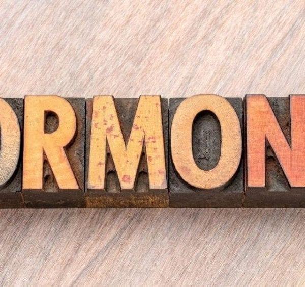 hormones on wooden background
