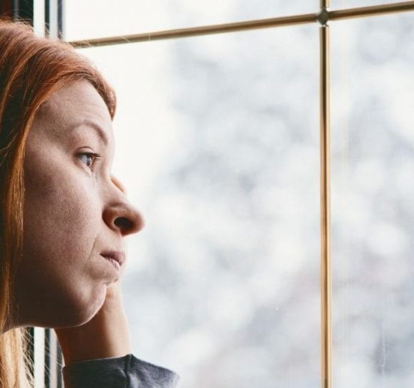 girl looking out on snow