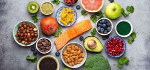 mixed colourful food on grey background