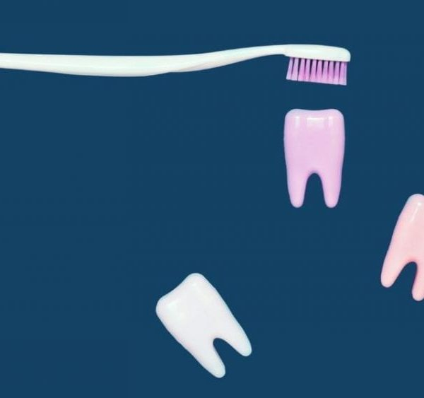 toothbrush and teeth on blue background