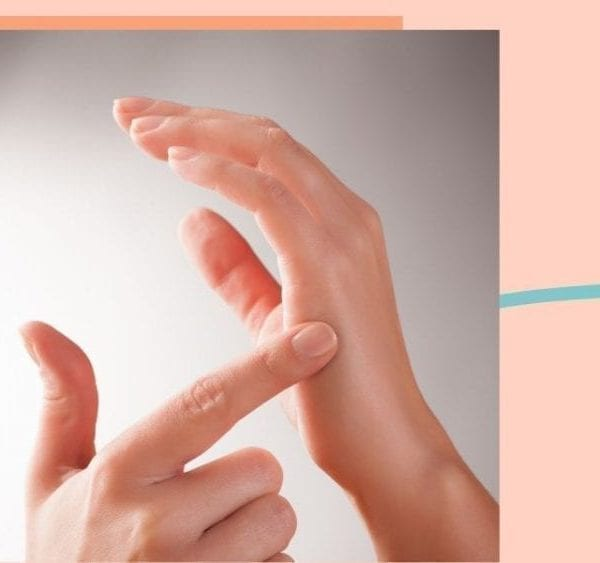 tapping fingers on hand on orange background