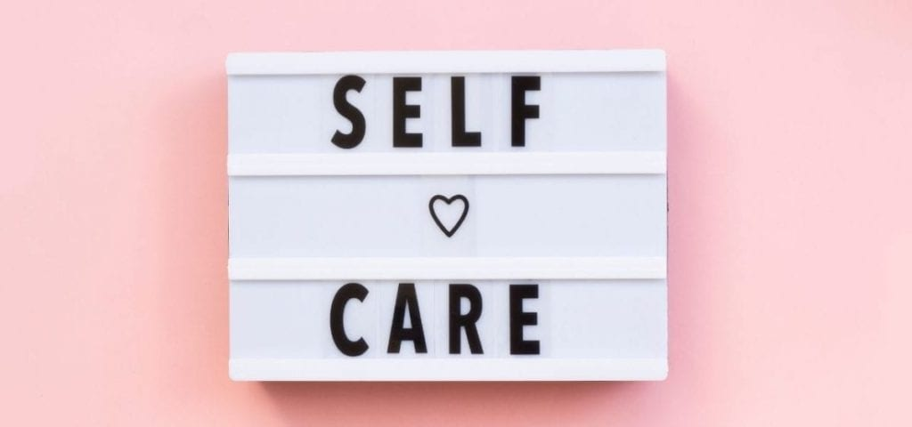 self care on pink background