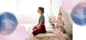 woman sat meditating on the floor