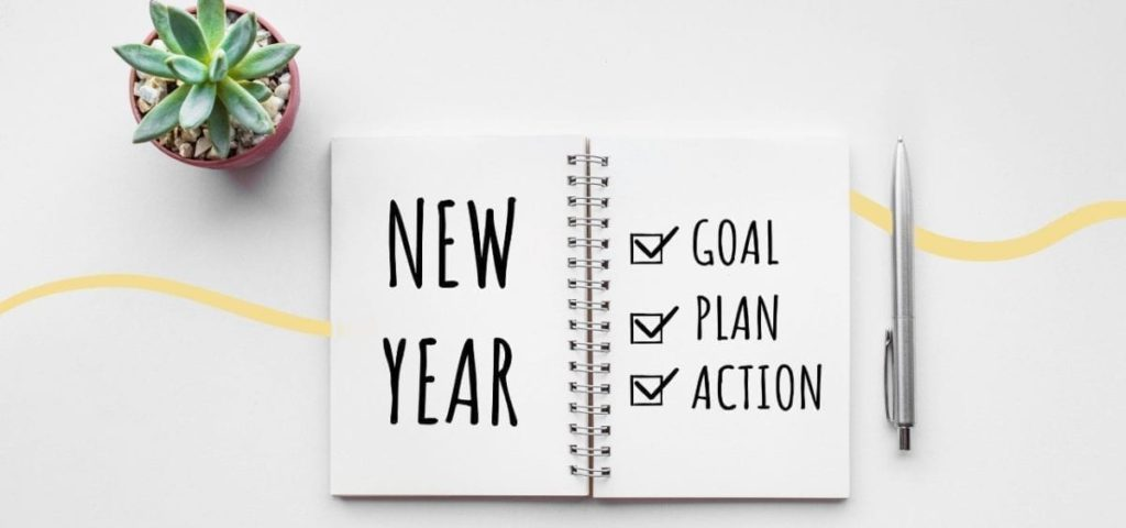 journal saying new year, goal, plan action