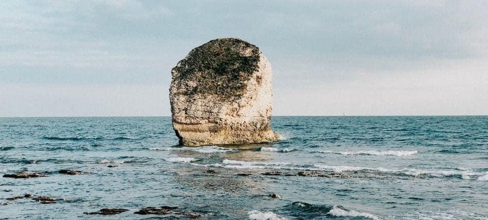 boulder in the sea