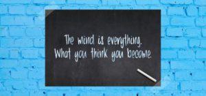 chalk board on blue brick wall