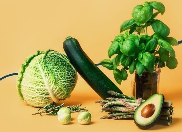 green vegetables on yellow background
