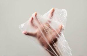 hand in plastic bag
