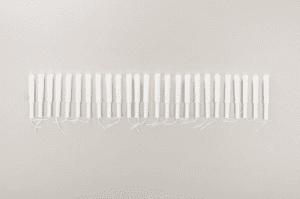 tampons lined up on a neutral background
