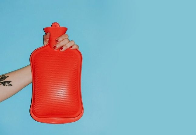 red water bottle on blue background