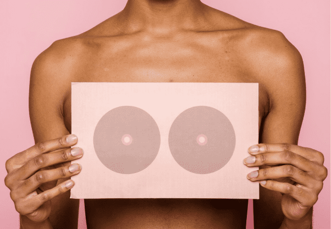 woman holding imager with two bulls eyes over her chest
